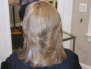 blond dimensional highlight flipped out long layers haircut